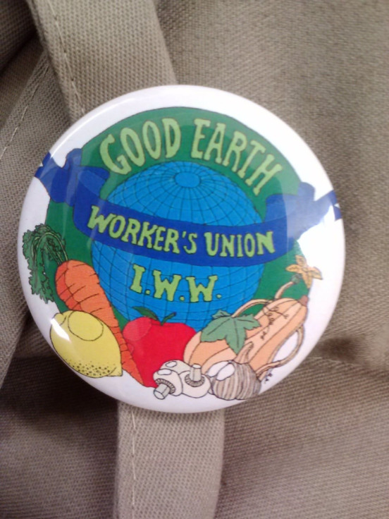 IWW Good Earth Workers' Union logo on a button | Image courtesy of the author