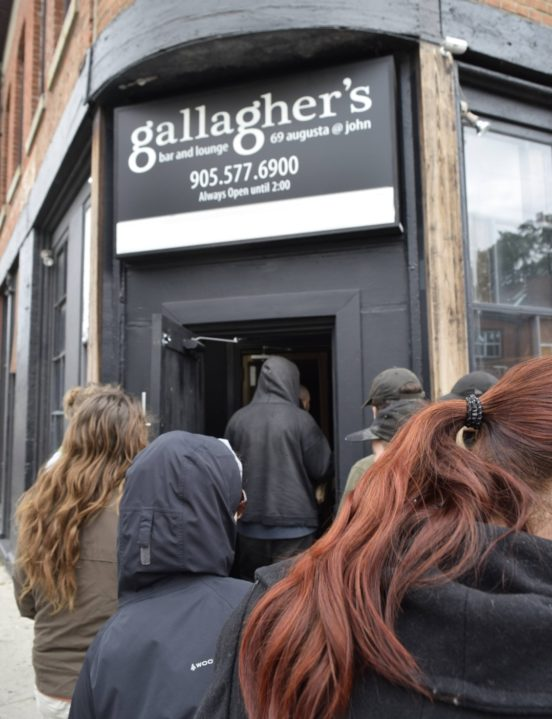 Hamilton Reclaim Your Pay campaign enters Gallagher's Bar, November 2018 | Image courtesy Hamilton IWW